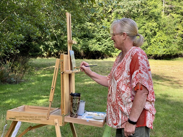 Jennifer Peers plein air painting in orchard photo by Terrill Welch