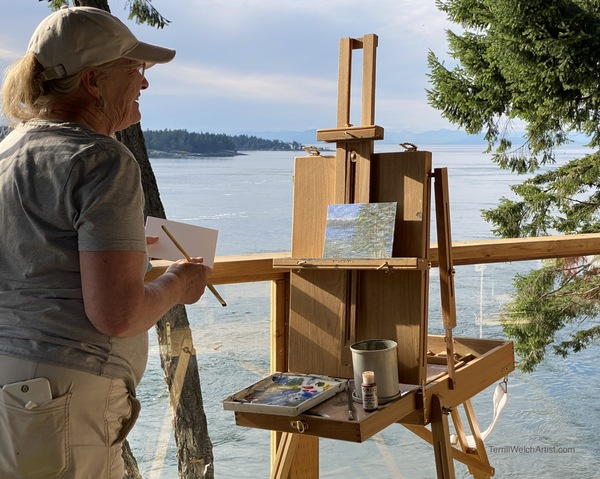Jennifer Peers plein air painting on her deck photo by Terrill Welch