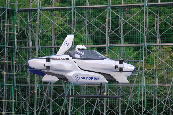 Japan's flying car soars in test flight with passenger aboard
