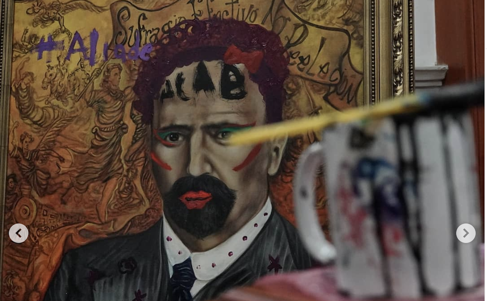 """Portraits of all-male historical figures were adorned with lipstick, eyeshadow, purple curls, """"ACAB,"""" anarchy symbols, and flowers. (photo by Andrea Murcia, @usagii_ko on Instagram)"""