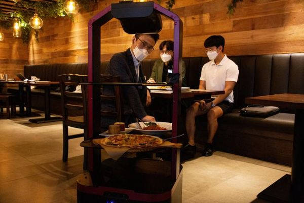 Better than humans? AI robot serves diners as South Korea restaurant ensures safe distancing amid Covid-19