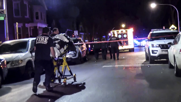 One of the 13 people wounded in a mass shooting last Dec. 22 in the 5700 block of South May Street in Englewood is rushed to a hospital. Afterward, the police and the federal Bureau of Alcohol, Tobacco, Firearms and Explosives worked to answer: Where did the gun come from? | Network Video Productions