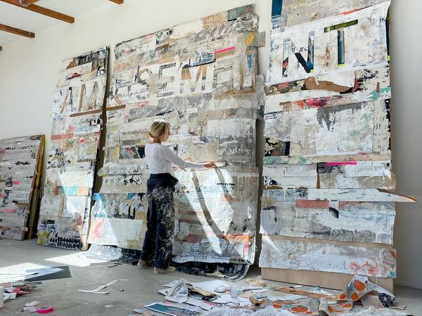 """Brigitte D'Annibale in her studio with the work """"AM   USEME   NT"""""""