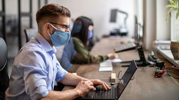 Working in an office instead of remotely may double COVID risk: CDC