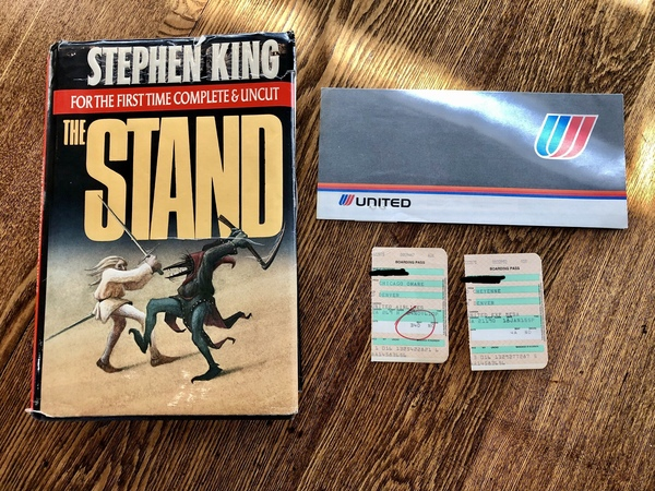 My copy of The Stand. I found these boarding passes my dad used as bookmarks — from back when you could smoke in planes! Also notable — Denver was his destination (if you read the book, you'll get the reference).