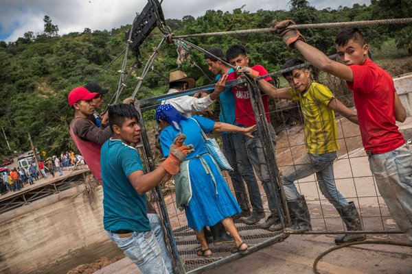 """""""A wire basket attached to a zip line where a bridge used to be in Jocotán, Guatemala."""" Source: NYT"""