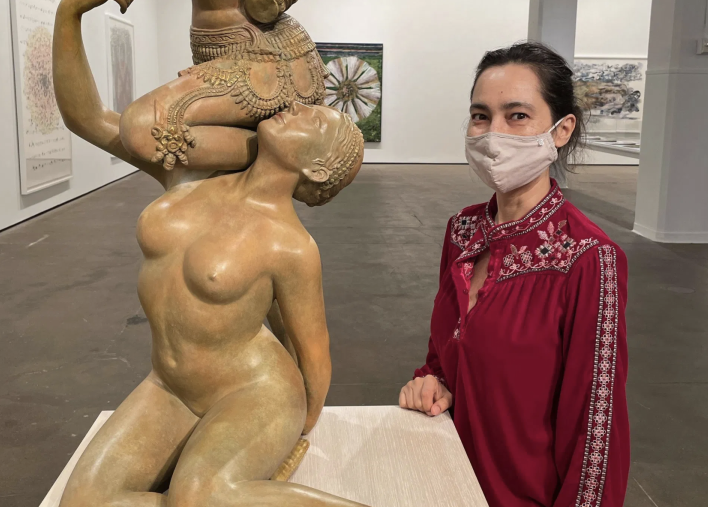 "The artist stands by her new sculpture, ""Promiscuous Intimacies"" (photo by the author for Hyperallergic)"