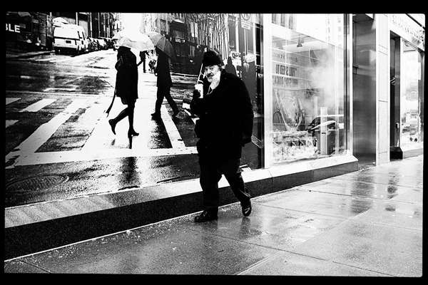 On East 58th Street, New York City, 17 December 2020. This is a street photo with one of my street photos in the background at 600 Madison Avenue. It is a curated collection of my photos.