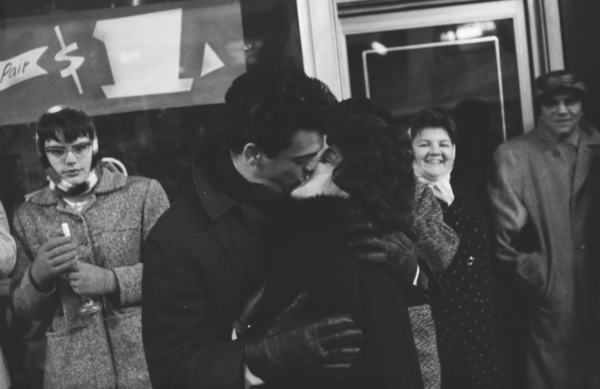 A happy couple standing in the Loop shares a midnight kiss to welcome in 1962. Photo by Bob Rubel/Chicago Sun-Times.