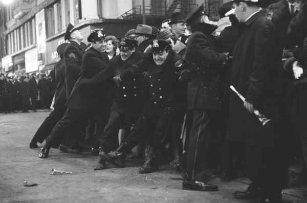 Chicago police restrain some of the New Year's Eve crowd celebrating at State and Randolph streets on Dec. 31, 1961. Photo by Bob Rubel/Chicago Sun-Times.