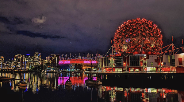 """Night shot of Olympic Village - that is not a Covid Ball monument its the Science Museum and their ad campaign is """"The world needs more nerds."""""""