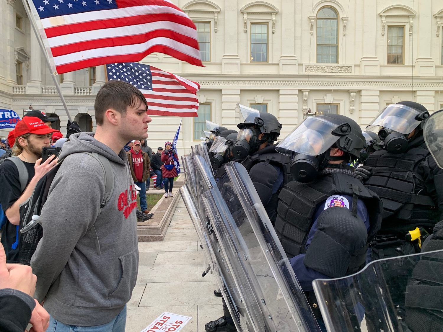 A participant in the pro-Trump mob faces off with heavily armed officers (image by Bucky Turco, used with permission)