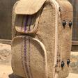 Skillful Ghanaian artisan repurposes cocoa sack into luxury traveling bag