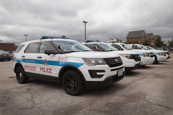 Police Interceptors sit in a police station parking lot. | Scott Olson/Getty Images