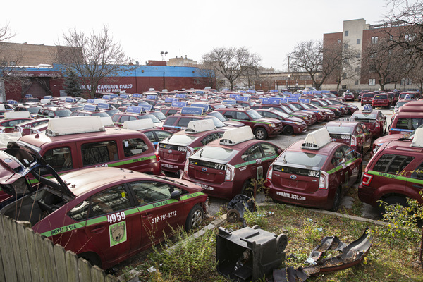 Cabs that were part of Symon Garber's taxicab empire sit idle at his Chicago Carriage Cab Co. headquarters at 2617 S. Wabash Ave. He has sold the property to a developer, and no one is even answering the phones there any longer. Anthony Vazquez / Sun-Times