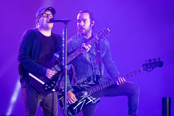 Patrick Stump (left) and Pete Wentz play at a 2018 Fall Out Boy concert at Wrigley Field. Ashlee Rezin Garcia/Sun-Times