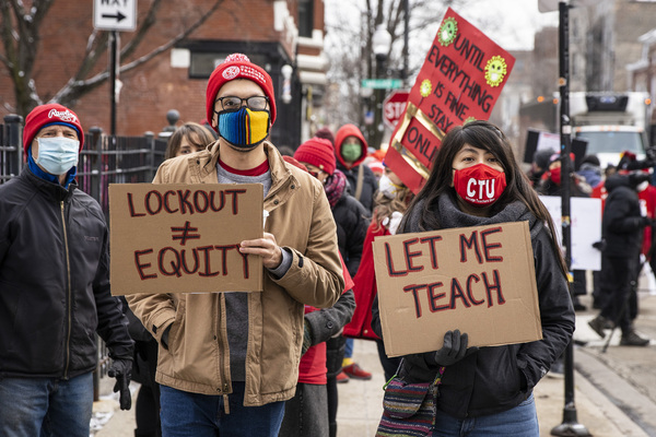 "Chicago Teachers Union members and their supporters march and protest in Pilsen to call for ""safety, equity and trust in any school reopening plan"" on Martin Luther King Jr. Day. 