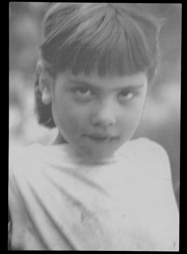 "Me at about 8 years of age. I only know that it was taken by George Phillips, a photographer friend of my father for a photo exhibit on ""The Moods of Children."""