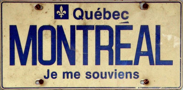 Je me souviens is the motto of Québec and it literally means 'I remember.' There is debate about the original meaning and it's possible that the true meaning is closer to we don't forget.
