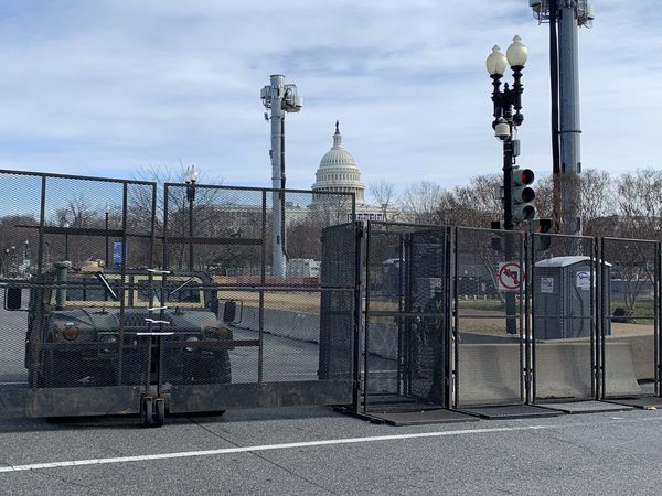 A National Guard Humvee at the inner perimeter. You can't get any closer to the Capitol than that.