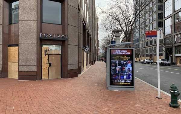 These wanted notices, with faces captured from social media videos of the Capitol riot, are on most bus shelters.