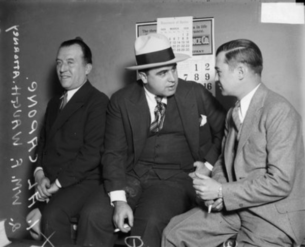 Attorney William F. Waugh of the American Legion, right, talking with Al Capone, center, in Chicago in March 1929.   From the Sun-Times archive.