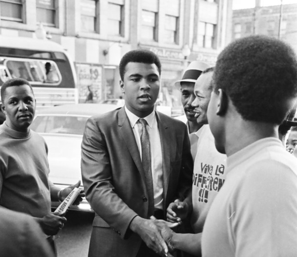 """Muhammad Ali greets a crowd outside the Senate Theater on July 24, 1967. """"The Greatest,"""" born Jan. 17, participated in a ceremony to donate items to starving families in Mississippi.   Photo by Pete Peters/Chicago Sun-Times"""