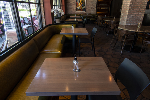 The indoor dining tables at Formento's Italian restaurant the West Loop. Bottles of hand sanitizer sit in the center of the tables instead of a centerpiece. | Tyler LaRiviere/Sun-Times