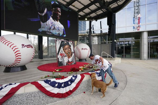A man honors Hank Aaron at Truist Park