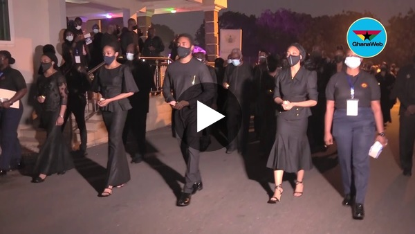 Ghana Armed Forces officers, Rawlings' children march during a vigil held in his honour
