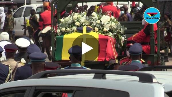 Pallbearers lift Rawlings' casket for burial