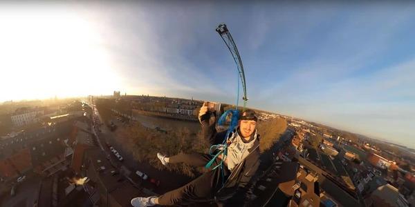 Il réalise un saut pendulaire depuis le sommet de la grue du Pont des Trous à Tournai  - Student maakt spectaculaire duik van kraan