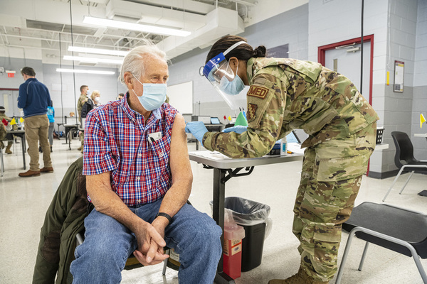 Melvin Glick, a retired physician, gets vaccinated at Cook County's second mass vaccination site at Triton College in River Grove last week. | Anthony Vazquez/Sun-Times