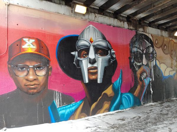 This new mural near Hubbard Street in the West Loop by Chicago artist Rahmaan Statik shows three versions of Daniel Dumile, the late rapper and hip-hop artist better known as MF DOOM. | Provided