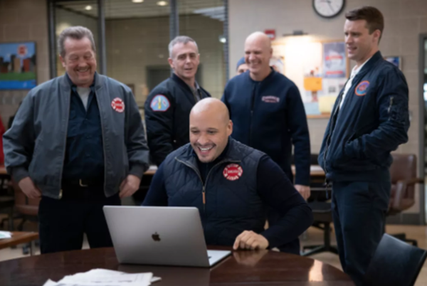 """""""Chicago Fire"""" cast member Joe Miñoso (sitting) wants to help the next generation of people of color and LGBTQIA+ students get into the film/TV industry. 