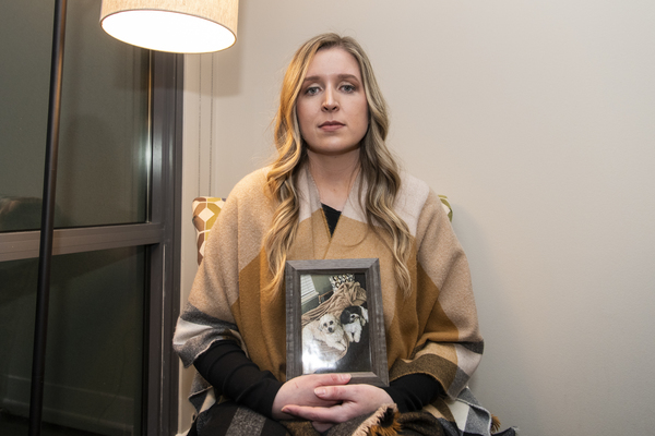 Sarah Manos holds a photo of her dogs Kirby (left) and Daisy, who she says were killed by a man she met on the dating app Bumble. | Tyler LaRiviere / Sun-Times