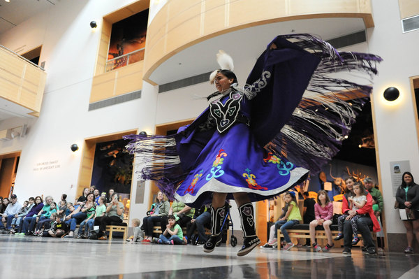 Leslie Deer performing a Native American Fancy Shawl Dance on Friday, March 17, 2017, during the last day of Spring Break Escape at Sam Noble Oklahoma Museum at University of Oklahoma, one of the grant's recipients. (photo by Kyle Phillips; courtesy the Norman Transcript)