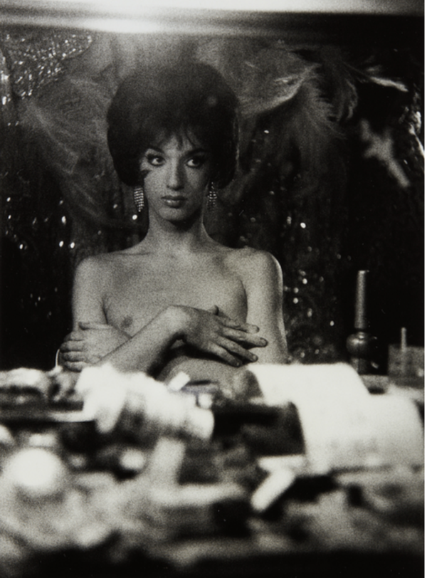 Diane Arbus - Seated female impersonator with arms crossed on her bare chest, N.Y.C., 1960 Gelatin silver print