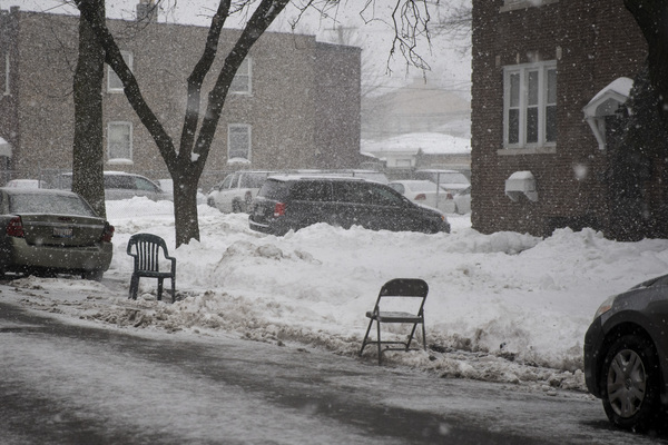 """A chair sits in a shoveled-out parking space as a """"dibs"""" on West Arthington Street near South Monitor Avenue in Austin on the West Side. 