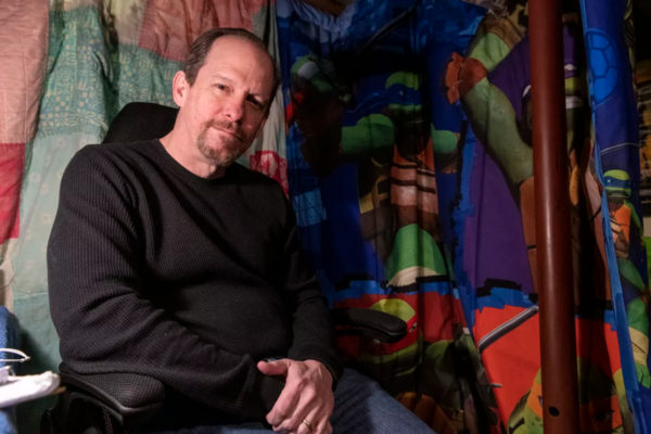 Actor and director Kevin Theis is photographed in his basement recording booth. | Tyler LaRiviere/Sun-Times