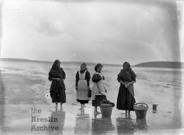 Four cockle pickers at Woodstown Strand, County Waterford in the 1890s.
