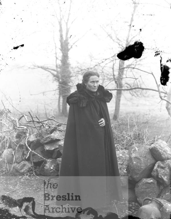 Portrait of a woman in a cloak.