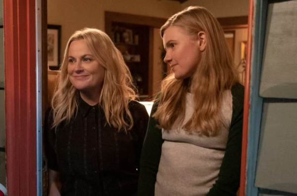 "Vivian (Hadley Robinson, right) finds inspiration in her mom Lisa (Amy Poehler) in ""Moxie."" 