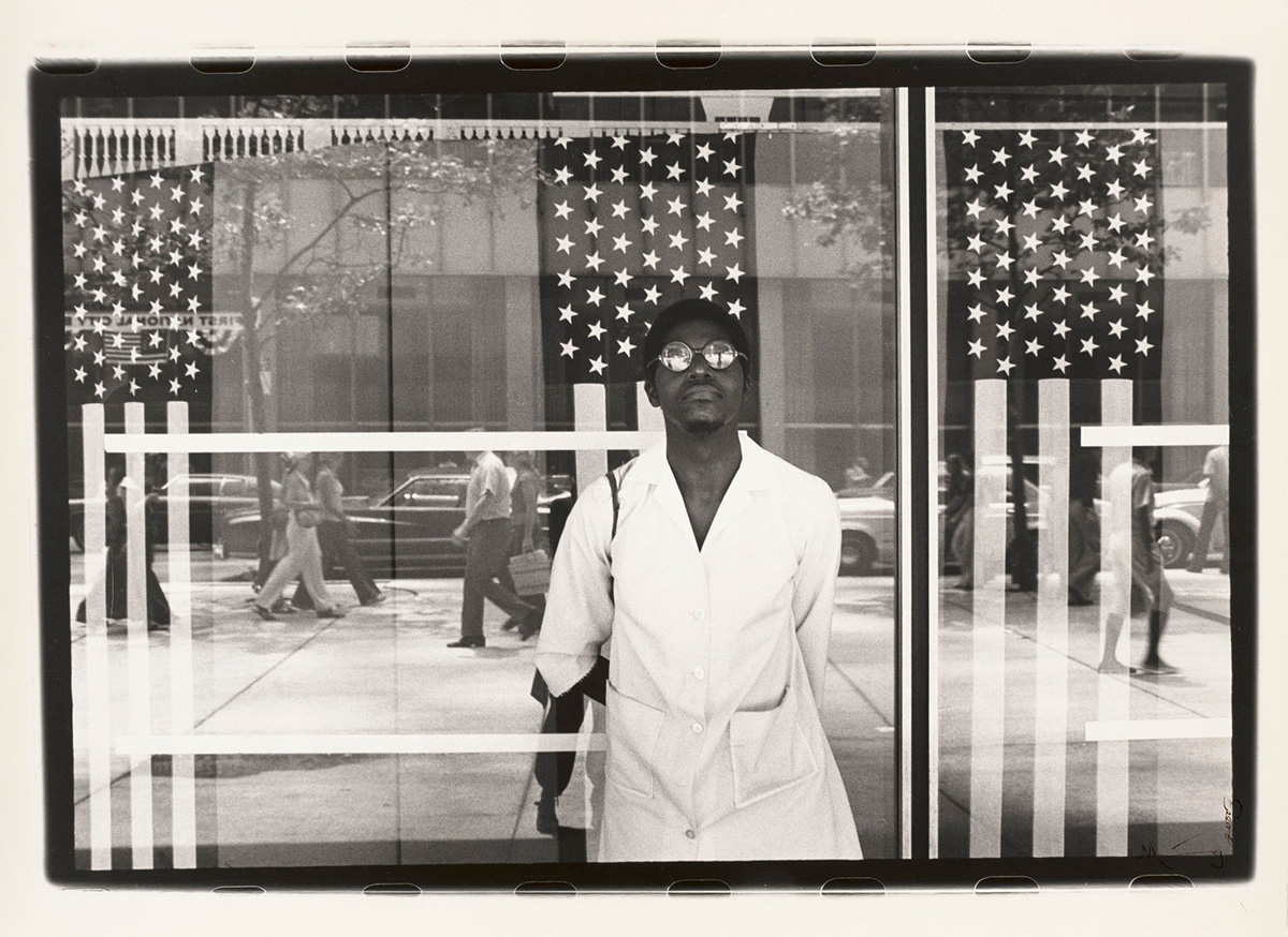 "Ming Smith, ""America seen through Stars and Stripes, New York City, New York"" (printed ca. 1976), gelatin silver print, sheet (image courtesy Virginia Museum of Fine Arts; © Ming Smith)"