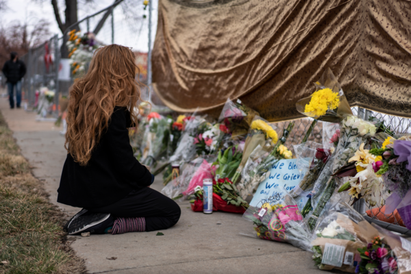 A mourner visits the location where a gunman opened fire at a King Sooper's grocery store on Monday in Boulder, Colorado. Ten people were killed in the attack. Chet Strange/Getty Images