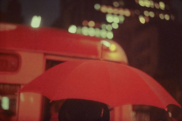 """Saul Leiter, Red Umbrella, 1951, from """"Early Color."""" Courtesy of Steidl."""