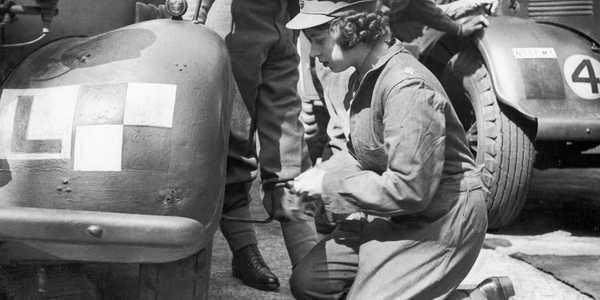 Princess Elizabeth learning car maintenance in 1945. Daily Mirror/Mirrorpix/