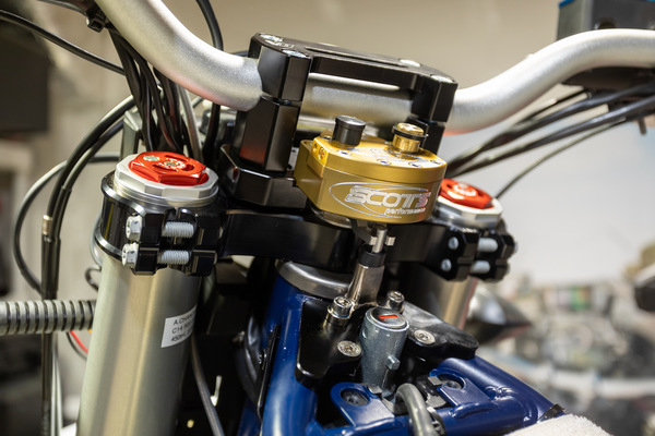 A sub-mount steering stabilizer solution which is not working because that frame bracket seen above the key hole conflicts with the bracket needed to mount the Long Range tank holder