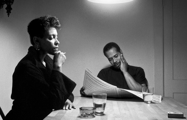 """Carrie Mae Weems. Courtesy of the artist and Jack Shainman Gallery, New York. The Kitchen Table series which was completed over a two year period (1989 to 1990), and has Weems cast as the central character in the photographs. """"I use my own constructed image as a vehicle for questioning ideas about the role of tradition, the nature of family, monogamy, polygamy, relationships between men and women, between women and their children, and between women and other women—underscoring the critical problems and the possible resolves."""""""