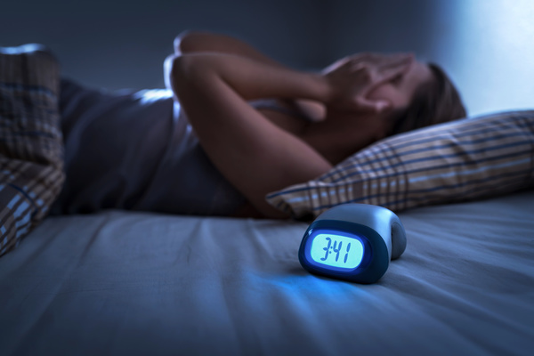 the description for this jpeg on the adobe stock page is: Sleepless woman suffering from insomnia, sleep apnea or stress. Tired and exhausted lady. Headache or migraine. Awake in the middle of the night. Frustrated person with problem.